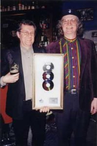 Photo of Kirk and Magoo holding the Children's Album of the Year award